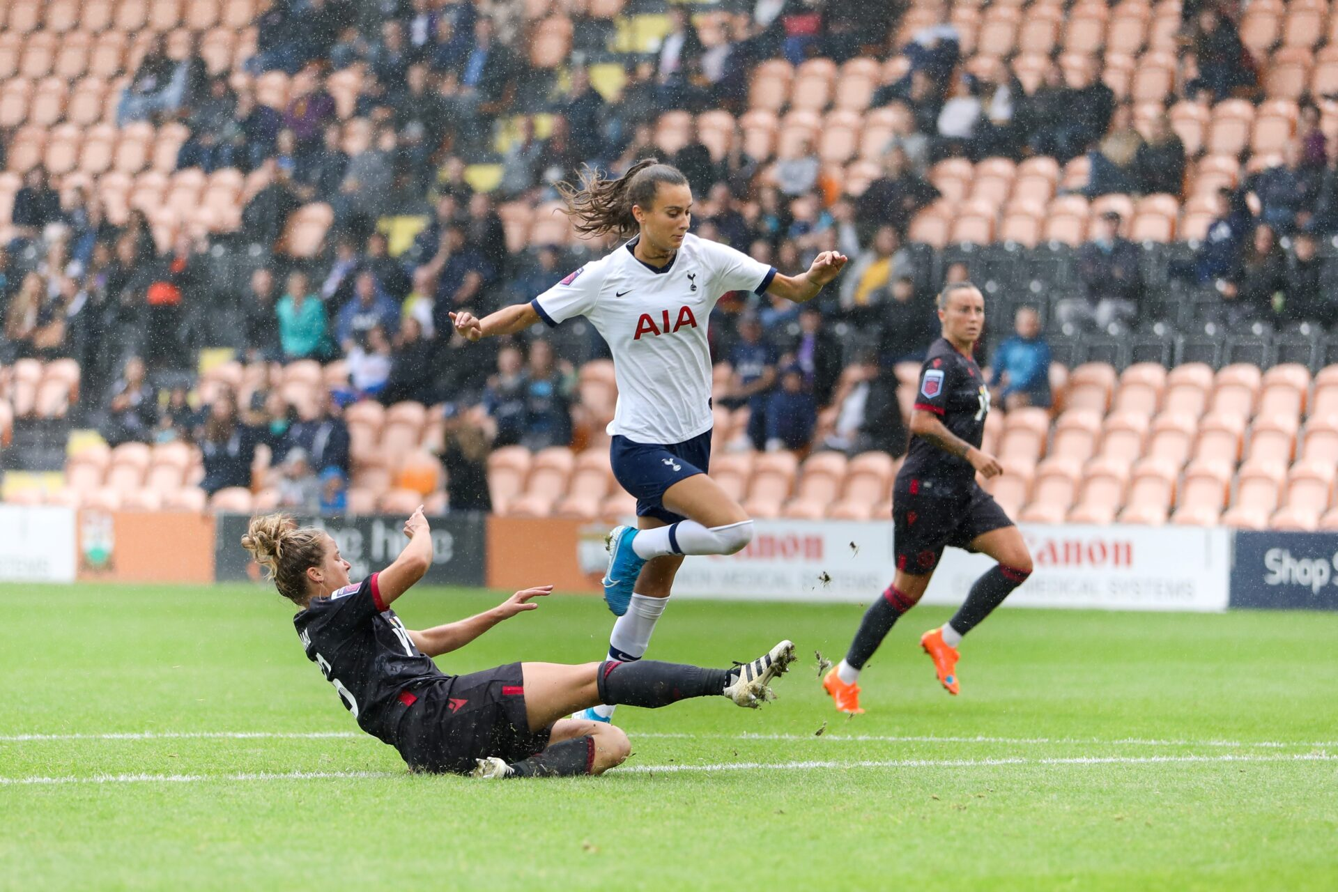 Rosella Ayane being tackled during a match against Reading