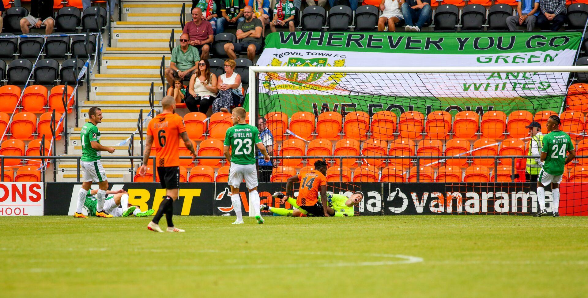 Stuart Nelson & Simeon Akinola colliding during a football match
